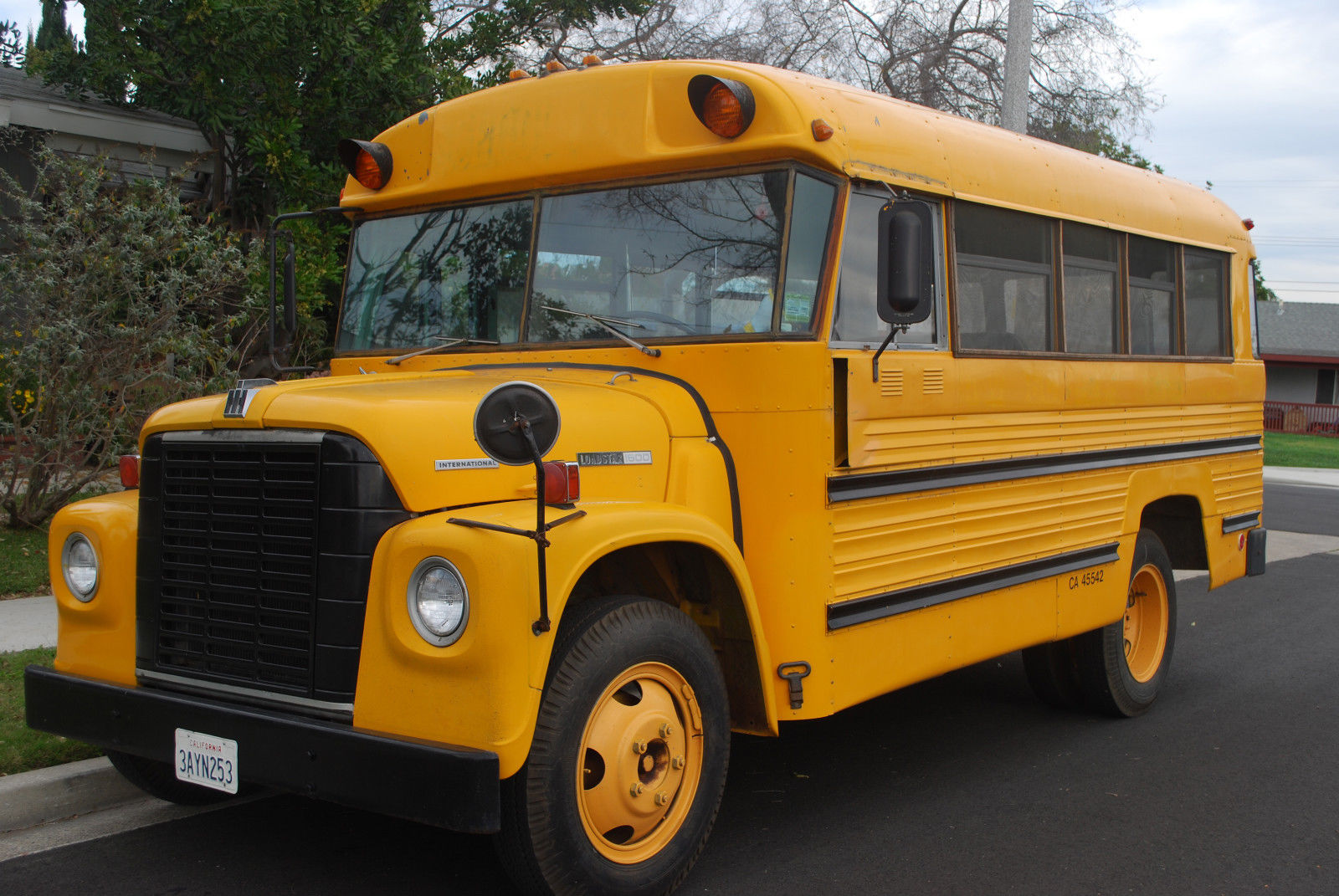 the short bus I left work early today so i could meet the bus i wait on our front porch, watching  other parents walk their kids home from the school around the corner.