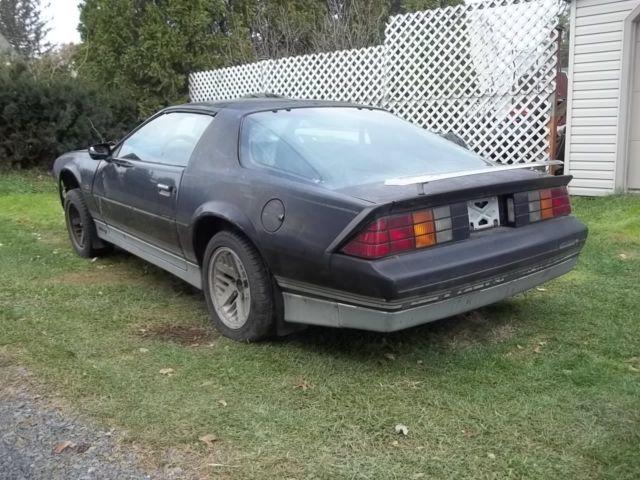 1985 camaro z28 black no motor    trans good roller rust