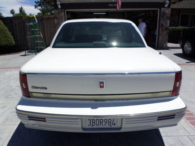 92 oldsmobile 98 white/blue cloth interior