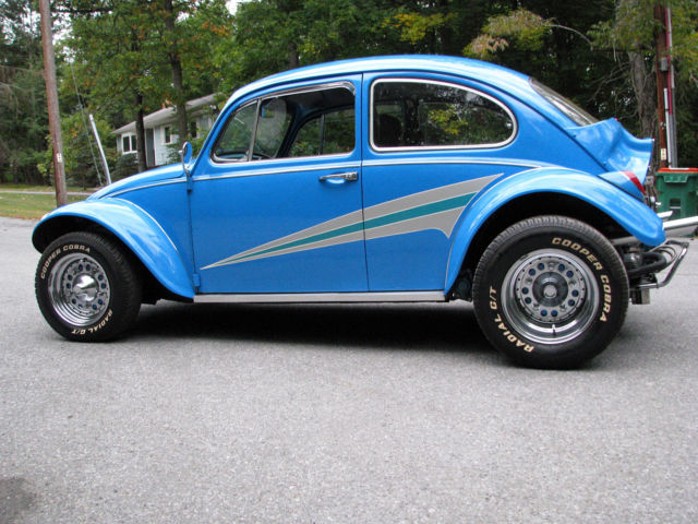 awesome baja bug big motor  interior newer rims  tires sharp paint fast classic