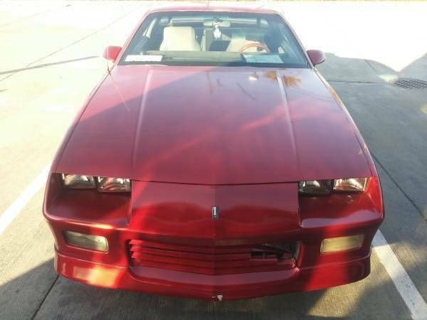 One Red 1989 Chevy Camaro RS V-8 305 , Rebuilt Manual